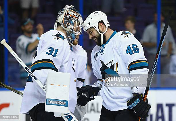 Martin Jones of the San Jose Sharks and Roman Polak celebrate defeating the St Louis Blues 63 in Game Five of the Western Conference Final during the...