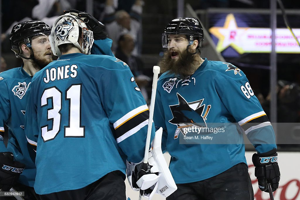 Martin Jones #31 of the San Jose Sharks celebrates with Brent Burns #88 after their 3-0 win over the St. Louis Blues in game three of the Western Conference Finals during the 2016 NHL Stanley Cup Playoffs at SAP Center on May 19, 2016 in San Jose, California.