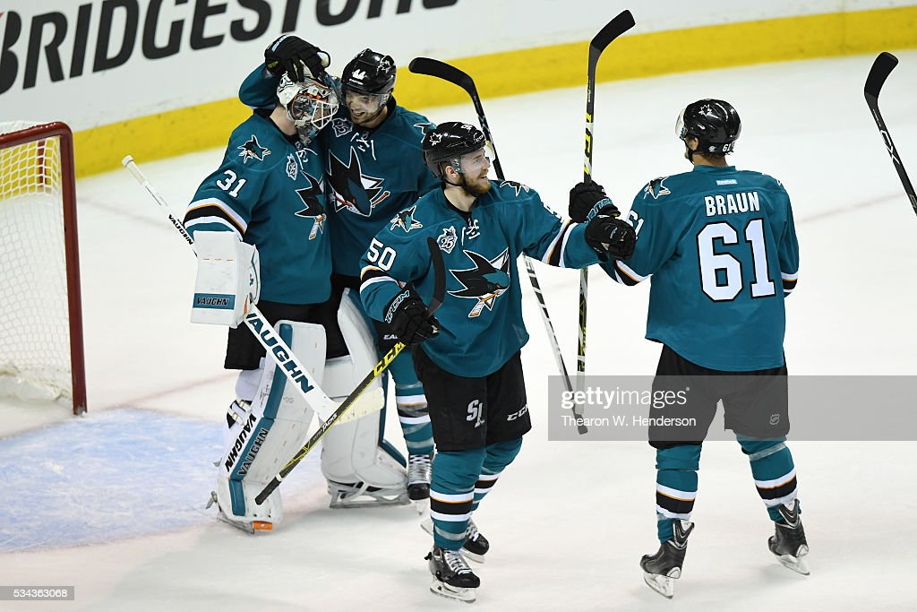 Martin Jones #31 of the San Jose Sharks celebrates with Marc-Edouard Vlasic #44, Chris Tierney #50 and Justin Braun #61 after defeating the St. Louis Blues 5-2 in Game Six of the Western Conference Final to advance to the the 2016 NHL Stanley Cup Final at SAP Center on May 25, 2016 in San Jose, California.