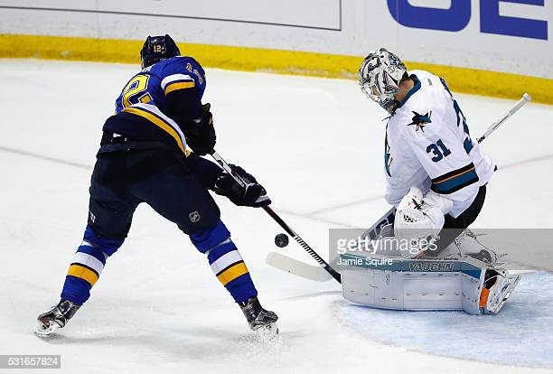 Martin Jones of the San Jose Sharks defends against Jori Lehtera of the St Louis Blues during the first period in Game One of the Western Conference...