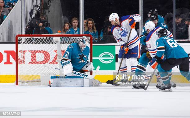 Martin Jones of the San Jose Sharks defends the net against Zack Kassian of the Edmonton Oilers in Game Four of the Western Conference First Round...