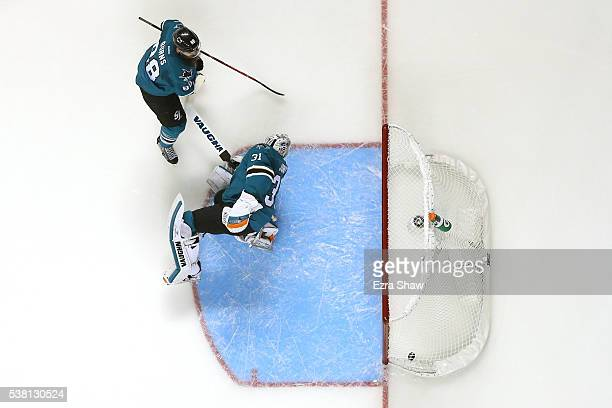 Martin Jones of the San Jose Sharks gives up a goal against Patric Hornqvist of the Pittsburgh Penguins with Brent Burns of the San Jose Sharks in...