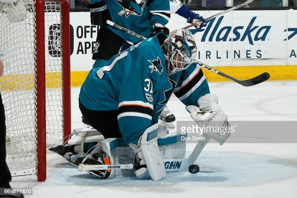 Martin Jones of the San Jose Sharks goes to cover the puck during a NHL game against the Vancouver Canucks at SAP Center at San Jose on April 4 2017...