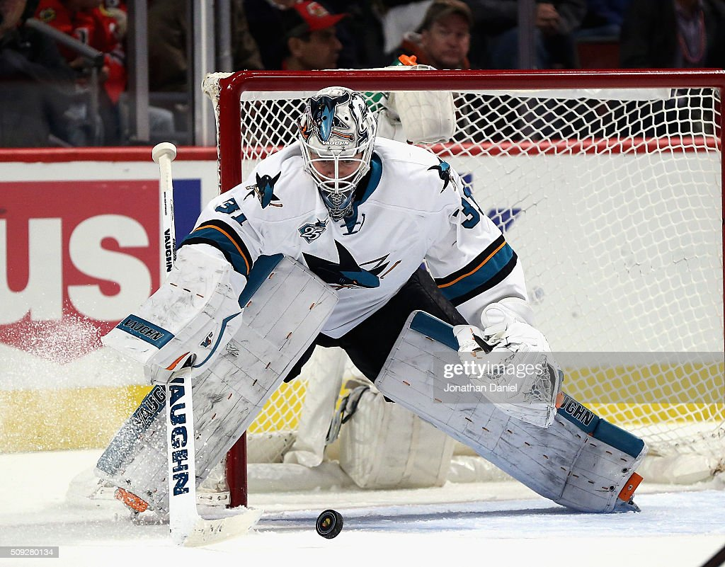Martin Jones of the San Jose Sharks makes a save in the third period against the Chicago Blackhawks at the United Center on February 9 2016 in...