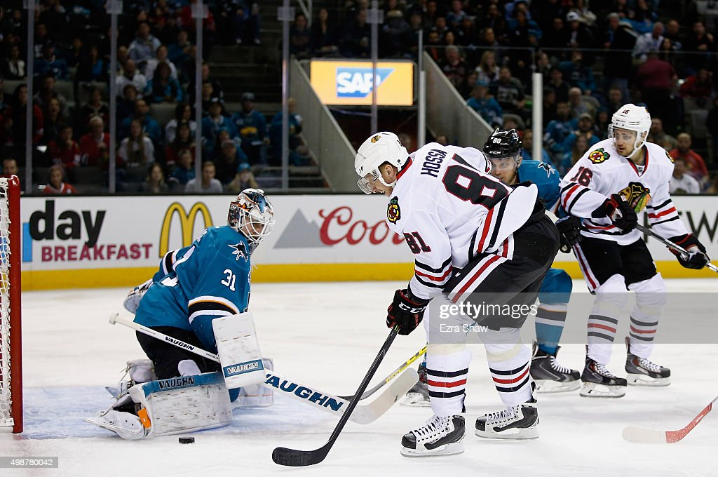 Martin Jones #31 of the San Jose Sharks makes a save on a shot taken by Marian Hossa #81 of the Chicago Blackhawks in the first period at SAP Center on November 25, 2015 in San Jose, California.