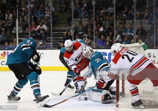 Martin Jones of the San Jose Sharks makes a save on a shot taken by Elias Lindholm of the Carolina Hurricanes at SAP Center on December 7 2017 in San...