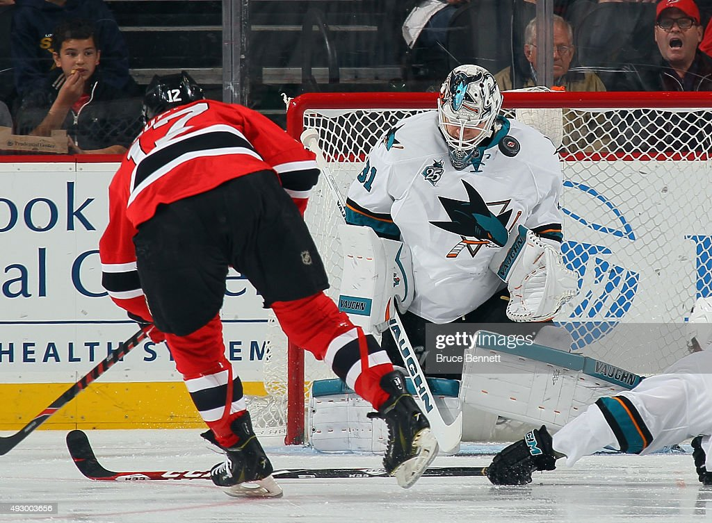 <a gi-track='captionPersonalityLinkClicked' href=/galleries/search?phrase=Martin+Jones+-+Ice+Hockey+Player&family=editorial&specificpeople=12318960 ng-click='$event.stopPropagation()'>Martin Jones</a> #31 of the San Jose Sharks makes the first period save on <a gi-track='captionPersonalityLinkClicked' href=/galleries/search?phrase=Reid+Boucher&family=editorial&specificpeople=7895490 ng-click='$event.stopPropagation()'>Reid Boucher</a> #12 of the New Jersey Devils at the Prudential Center on October 16, 2015 in Newark, New Jersey.