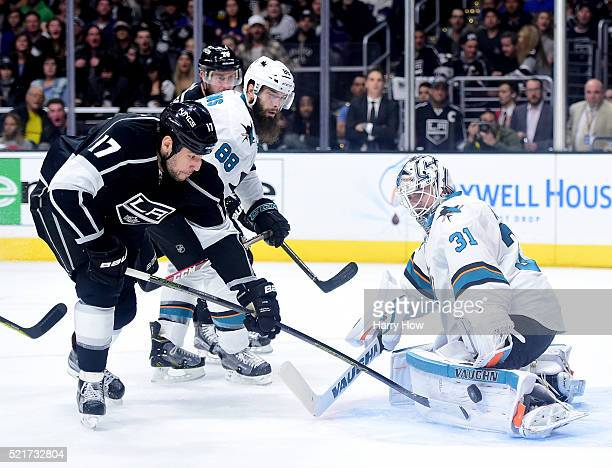 Martin Jones of the San Jose Sharks stops Milan Lucic of the Los Angeles Kings on a rebound as Brent Burns looks on during the second period in Game...