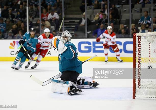 Martin Jones of the San Jose Sharks watches the puck go by on a goal scored by Sebastian Aho of the Carolina Hurricanes in the first period at SAP...