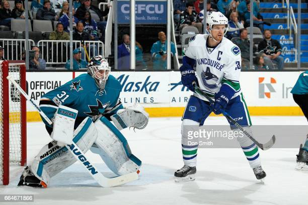 Martin Jones the San Jose Sharks defends Henrik Sedin of the Vancouver Canucks during a NHL game at SAP Center at San Jose on April 4 2017 in San...