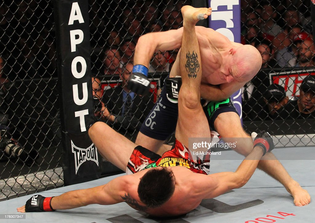 Martin Kampmann punches Carlos Condit in their welterweight fight during the UFC on FOX Sports 1 event at Bankers Life Fieldhouse on August 28 2013...