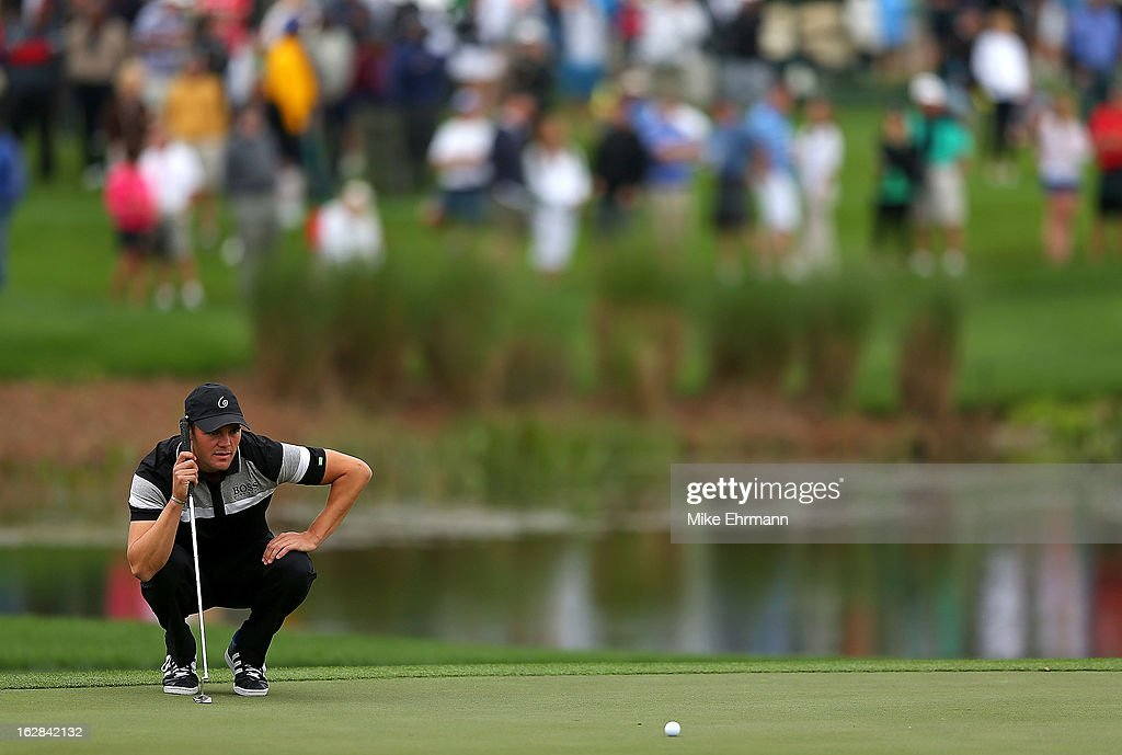 Martin Kaymer from Germany lines up a putt on the fourth hole during the first round of the Honda Classic at PGA National Resort and Spa on February 28, 2013 in Palm Beach Gardens, Florida.