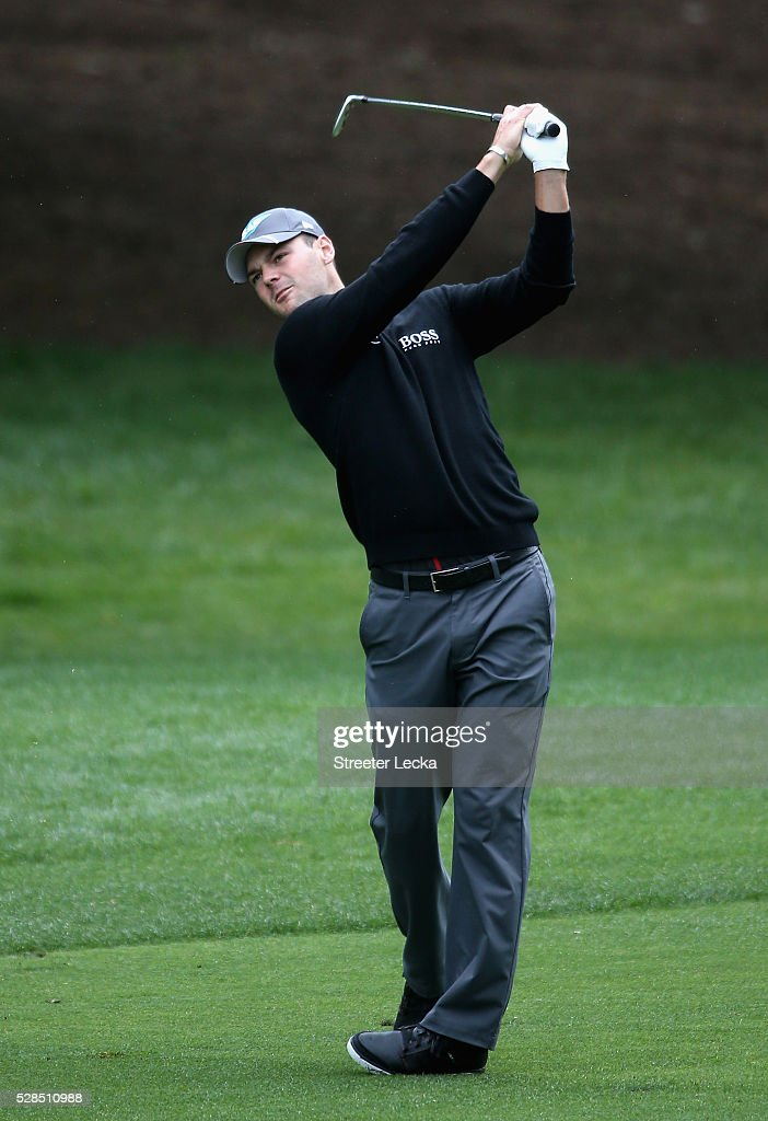 Martin Kaymer hits a shot on the third hole during the first round of the 2016 Wells Fargo Championship at Quail Hollow Club on May 5, 2016 in Charlotte, North Carolina.