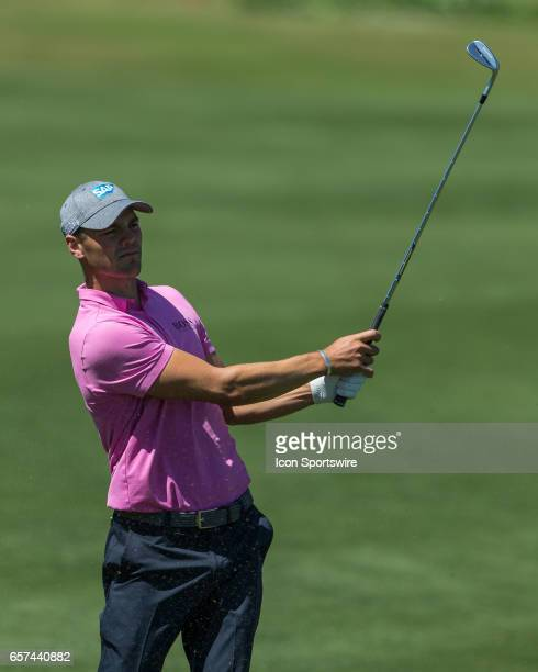Martin Kaymer hits an approach shot that almost falls into the water on the thirteenth hole during the second round of the WGCDell Technologies Match...