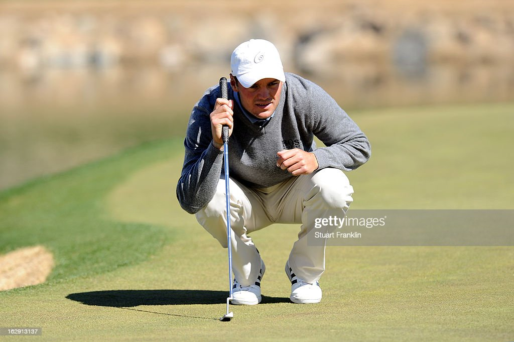 Martin Kaymer lines up a putt during the third round of the World Golf Championships - Accenture Match Play at the Golf Club at Dove Mountain on February 23, 2013 in Marana, Arizona.