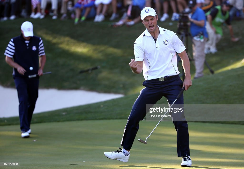 Martin Kaymer of Europe celebrates a par putt on the 17th green as Steve Stricker of the USA looks on during the Singles Matches for The 39th Ryder...