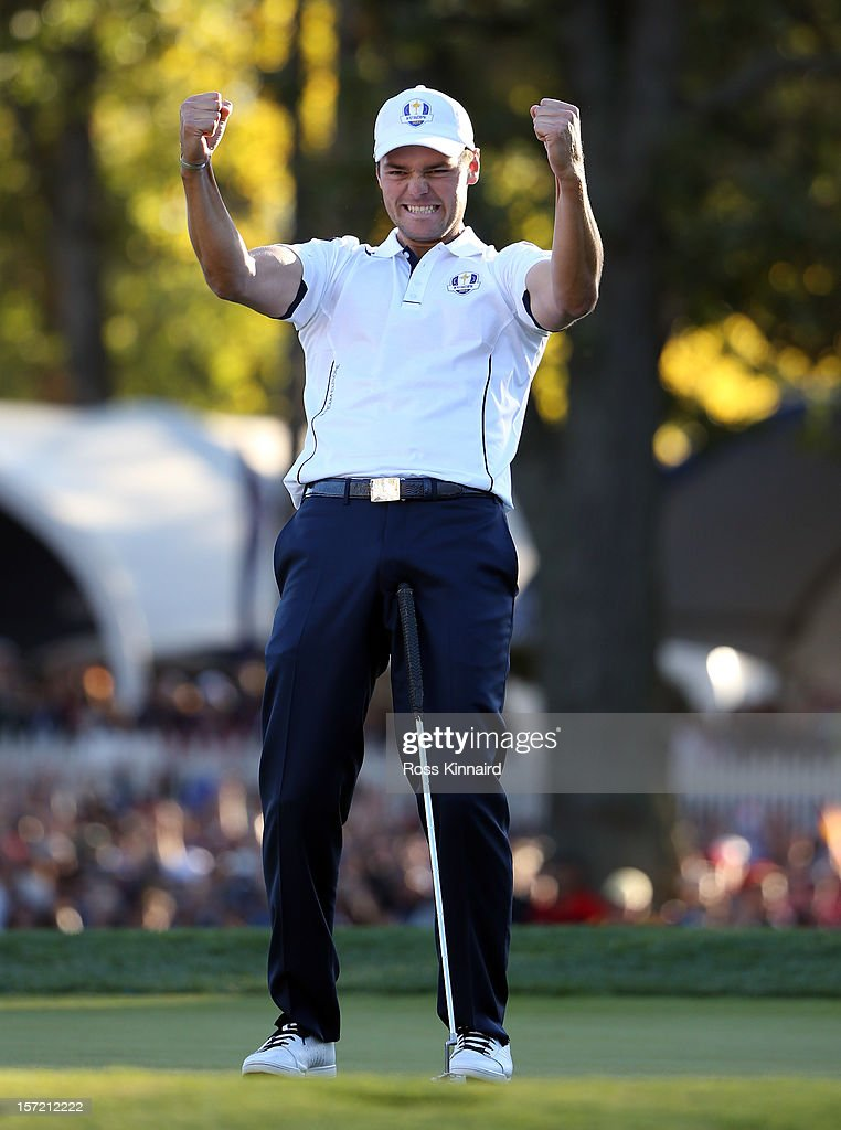 Martin Kaymer of Europe celebrates after making the putt that retained the Ryder Cup on the the 18th green in his match against Steve Stricker during...