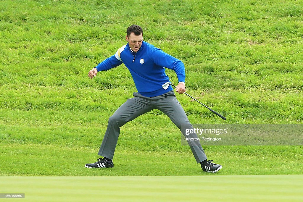 Martin Kaymer of Europe celebrates chipping in on the 16th hole to defeat Bubba Watson of the United States during the Singles Matches of the 2014 Ryder Cup on the PGA Centenary course at the Gleneagles Hotel on September 28, 2014 in Auchterarder, Scotland.