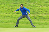 Martin Kaymer of Europe celebrates chipping in on the 16th hole to defeat Bubba Watson of the United States during the Singles Matches of the 2014...