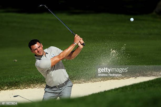 Martin Kaymer of Europe plays a shot from a bunker on the third hole during afternoon fourball matches of the 2016 Ryder Cup at Hazeltine National...