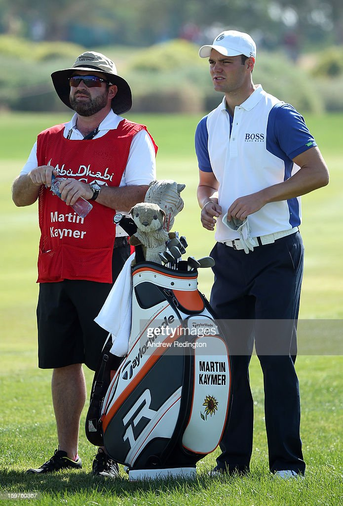 Martin Kaymer of Germany (R) and his caddie Craig Connelly during the final round of The Abu Dhabi HSBC Golf Championship at Abu Dhabi Golf Club on January 20, 2013 in Abu Dhabi, United Arab Emirates.