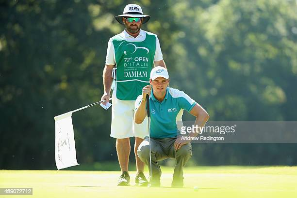 Martin Kaymer of Germany and his caddie Craig Connelly line up a putt on the second hole during the third round of the 72nd Open d'Italia at Golf...