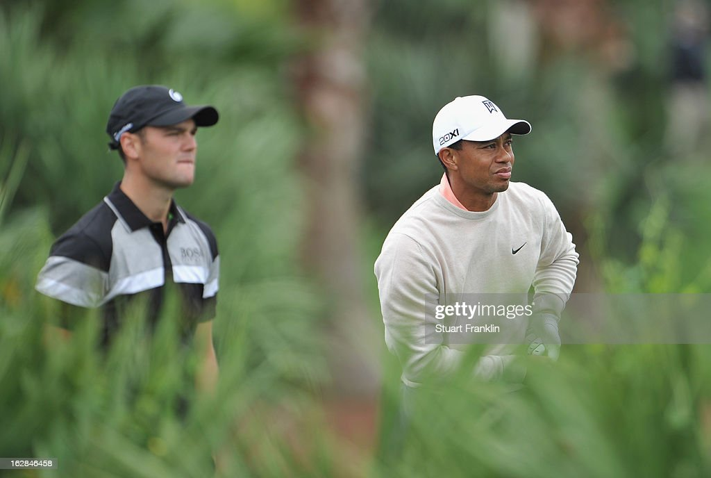 Martin Kaymer of Germany and Tiger Woods of USA watch on the second hole during the first round of the Honda Classic on February 28, 2013 in Palm Beach Gardens, Florida.