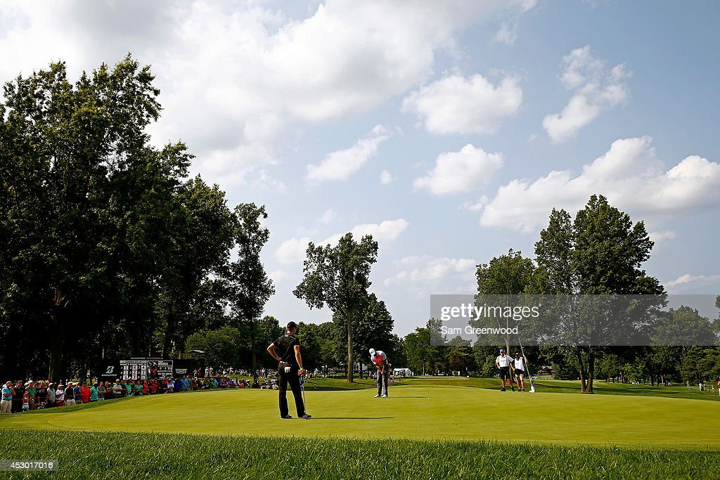 <a gi-track='captionPersonalityLinkClicked' href=/galleries/search?phrase=Martin+Kaymer&family=editorial&specificpeople=2143733 ng-click='$event.stopPropagation()'>Martin Kaymer</a> of Germany and <a gi-track='captionPersonalityLinkClicked' href=/galleries/search?phrase=Tiger+Woods&family=editorial&specificpeople=157537 ng-click='$event.stopPropagation()'>Tiger Woods</a> prepare to putt on the 12th green during the first round of the World Golf Championships-Bridgestone Invitational at Firestone Country Club South Course on July 31, 2014 in Akron, Ohio.