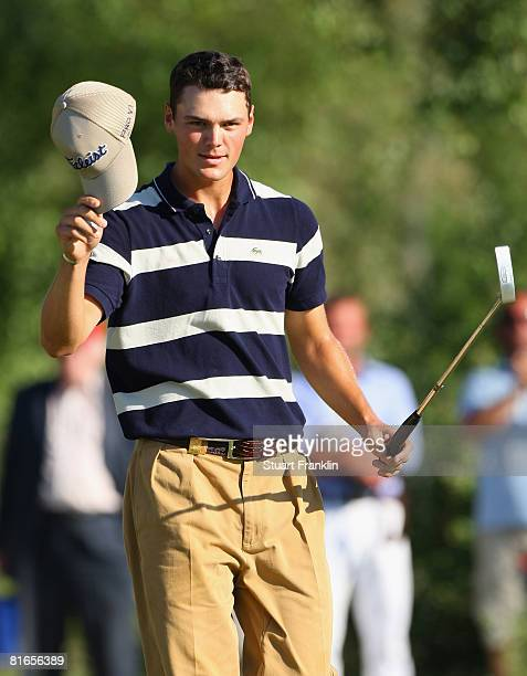 Martin Kaymer of Germany celebrates his birdie putt on the 18th hole during the third round of The BMW International Open Golf at The Munich North...