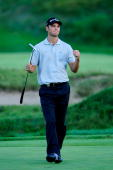 Martin Kaymer of Germany celebrates on the 18th green after defeating Bubba Watson during the threehole aggregate playoff following the final round...