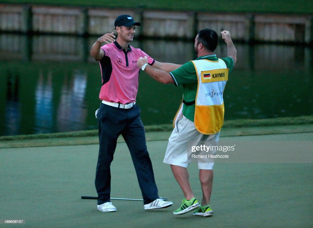 Martin Kaymer of Germany celebrates on the 18th green with his caddie Craig Connelly after his onestroke victory at THE PLAYERS Championship on The...