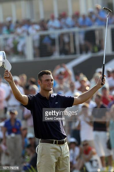 Martin Kaymer of Germany celebrates securing the Race to Dubai Trophy on the 18th green during the final round of the Dubai World Championship on the...