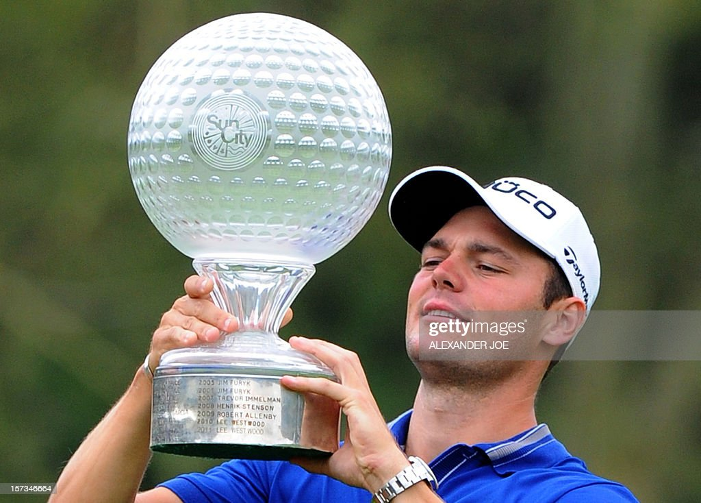 Martin Kaymer of Germany celebrates winning the 2012 Nedbank Golf Challenge in Sun City on December 2 ,2012. AFP PHOTO / Alexander Joe