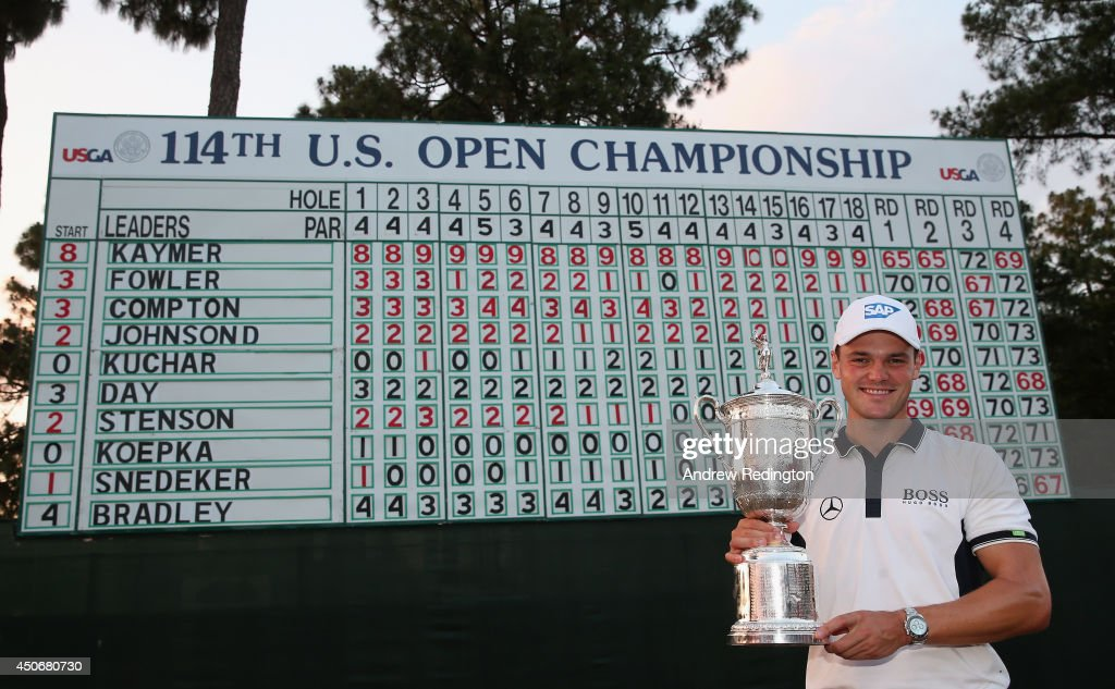 <a gi-track='captionPersonalityLinkClicked' href=/galleries/search?phrase=Martin+Kaymer&family=editorial&specificpeople=2143733 ng-click='$event.stopPropagation()'>Martin Kaymer</a> of Germany celebrates with the trophy in front of the leaderboard after his eight-stroke victory during the final round of the 114th U.S. Open at Pinehurst Resort & Country Club, Course No. 2 on June 15, 2014 in Pinehurst, North Carolina.
