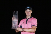 Martin Kaymer of Germany celebrates with the winner's trophy after his onestroke victory at THE PLAYERS Championship on The Stadium Course at TPC...