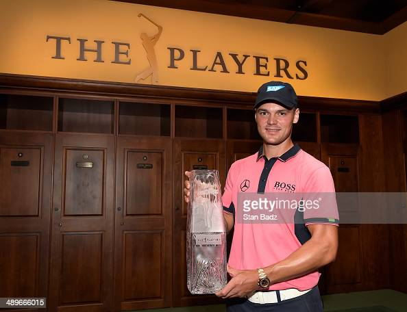 Martin Kaymer of Germany celebrates with the winner's trophy after his onestroke victory at THE PLAYERS Championship during the final round of THE...