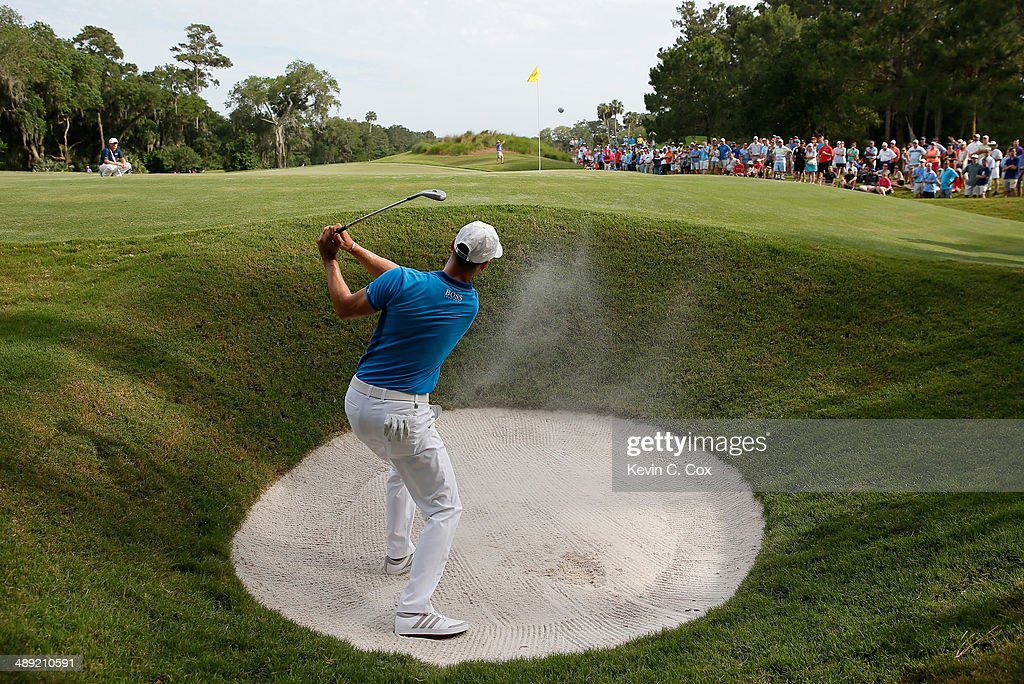 <a gi-track='captionPersonalityLinkClicked' href=/galleries/search?phrase=Martin+Kaymer&family=editorial&specificpeople=2143733 ng-click='$event.stopPropagation()'>Martin Kaymer</a> of Germany hits a bunker shot on the 12th hole during the third round of THE PLAYERS Championship on the stadium course at TPC Sawgrass on May 10, 2014 in Ponte Vedra Beach, Florida.