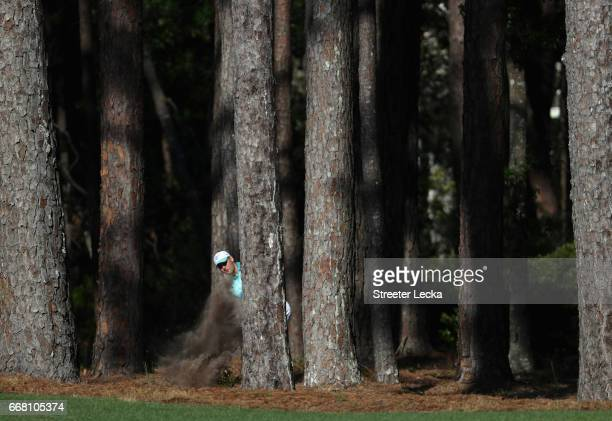 Martin Kaymer of Germany hits a shot from the trees on the 15th hole during the first round of the 2017 RBC Heritage at Harbour Town Golf Links on...