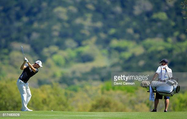 Martin Kaymer of Germany hits a shot on the sixth hole as his caddie Craig Connelly looks on during the third round of the World Golf...
