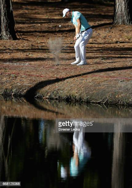 Martin Kaymer of Germany hits a shot over the water on the 15th hole during the first round of the 2017 RBC Heritage at Harbour Town Golf Links on...