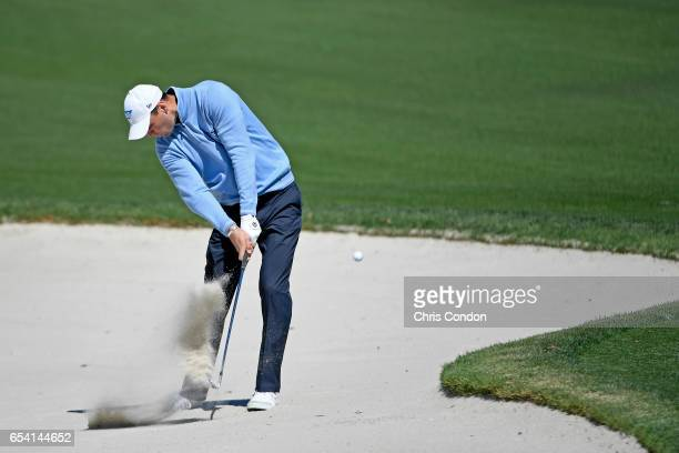 Martin Kaymer of Germany hits from the bunker at No 5 during the first round of the Arnold Palmer Invitational presented by MasterCard at Bay Hill...