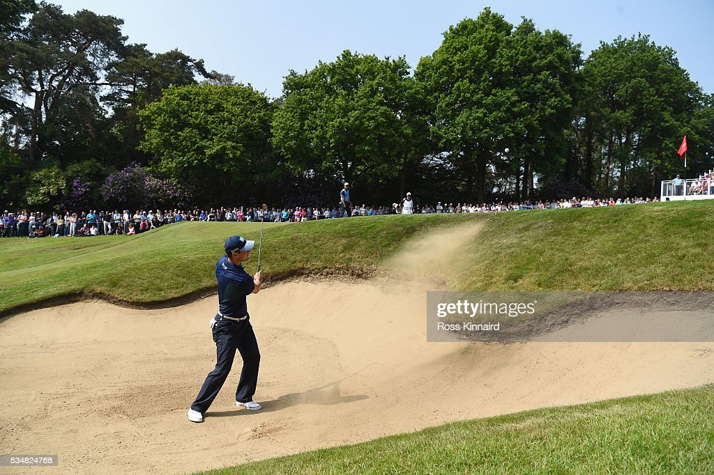 Martin Kaymer of Germany hits his 2nd shot on the 14th hole during day three of the BMW PGA Championship at Wentworth on May 28 2016 in Virginia...
