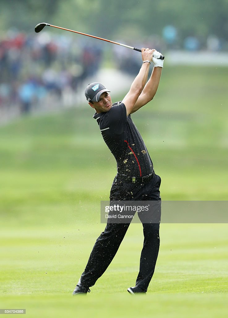 <a gi-track='captionPersonalityLinkClicked' href=/galleries/search?phrase=Martin+Kaymer&family=editorial&specificpeople=2143733 ng-click='$event.stopPropagation()'>Martin Kaymer</a> of Germany hits his 2nd shot on the 17th hole during day two of the BMW PGA Championship at Wentworth on May 27, 2016 in Virginia Water, England.