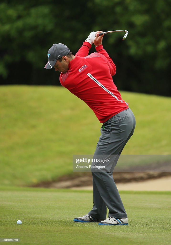 Martin Kaymer of Germany hits his 2nd shot on the 18th hole during the Pro-Am prior to the BMW PGA Championship at Wentworth on May 25, 2016 in Virginia Water, England.