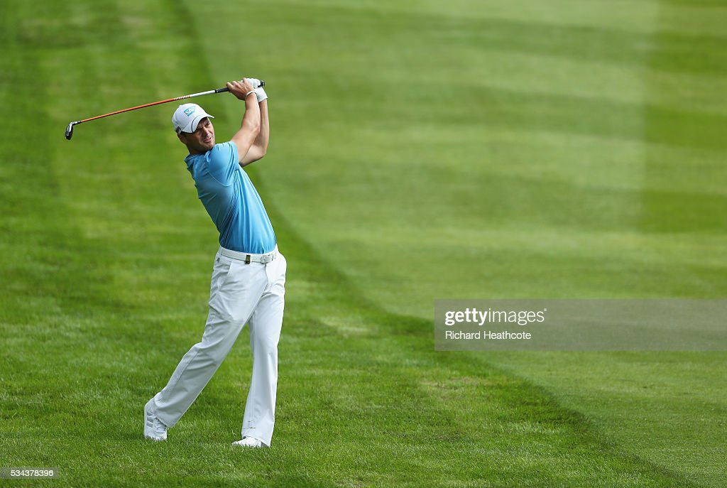 Martin Kaymer of Germany hits his 2nd shot on the 4th hole during day one of the BMW PGA Championship at Wentworth on May 26, 2016 in Virginia Water, England.
