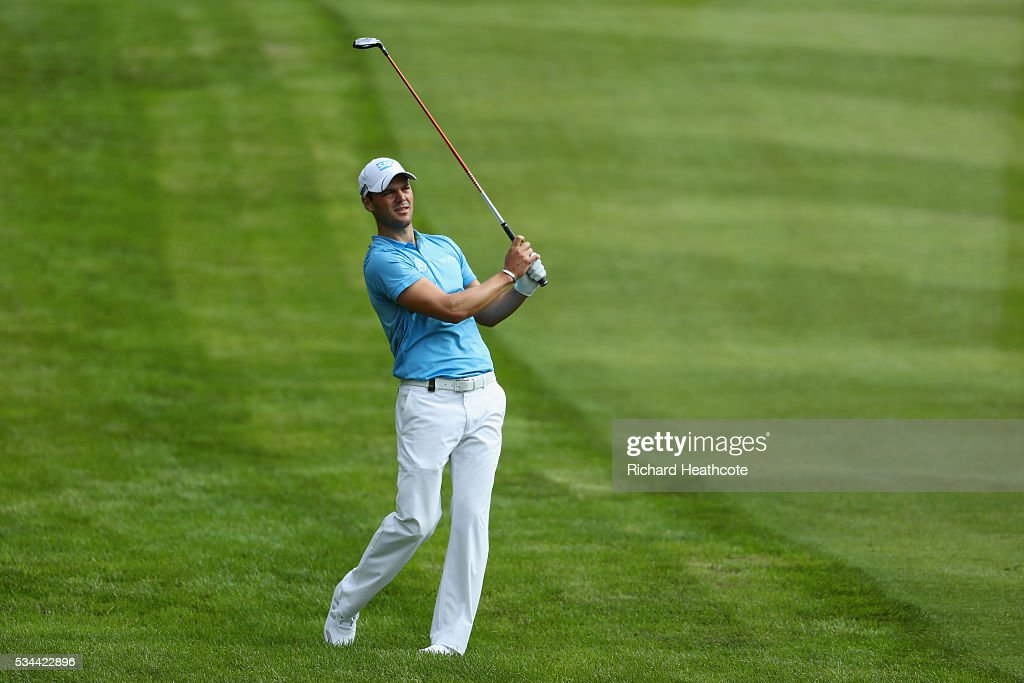 <a gi-track='captionPersonalityLinkClicked' href=/galleries/search?phrase=Martin+Kaymer&family=editorial&specificpeople=2143733 ng-click='$event.stopPropagation()'>Martin Kaymer</a> of Germany hits his 2nd shot on the 4th hole during day one of the BMW PGA Championship at Wentworth on May 26, 2016 in Virginia Water, England.