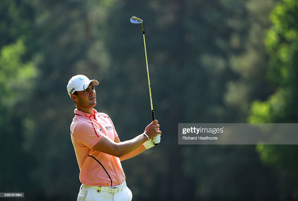 <a gi-track='captionPersonalityLinkClicked' href=/galleries/search?phrase=Martin+Kaymer&family=editorial&specificpeople=2143733 ng-click='$event.stopPropagation()'>Martin Kaymer</a> of Germany hits his 3rd shot on the 13th hole during day four of the BMW PGA Championship at Wentworth on May 29, 2016 in Virginia Water, England.
