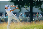 Martin Kaymer of Germany hits his second shot from the rough on the fourth hole during the continuation of the second round of the US Open at Oakmont...