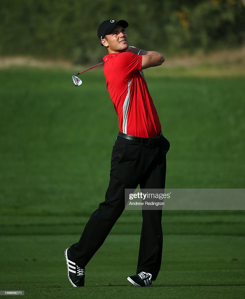 Martin Kaymer of Germany hits his second shot on the 12th hole during the second round of the Commercial Bank Qatar Masters held at Doha Golf Club on January 24, 2013 in Doha, Qatar.