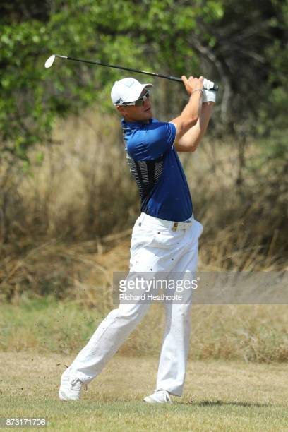 Martin Kaymer of Germany hits his second shot on the 15th hole during the final round of the Nedbank Golf Challenge at Gary Player CC on November 12...